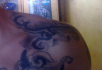 adi-warded-shoulder-tattoo